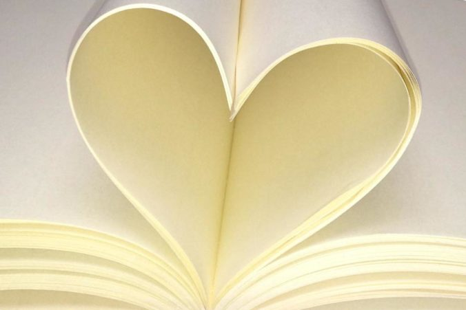 Notebook pages folded into a heart-shape